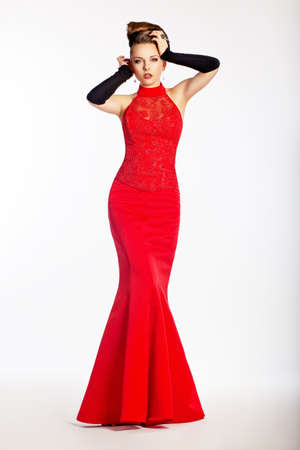 Graceful newlywed in luxurious wedding red dress. Perfection. Luxury and glamour photo