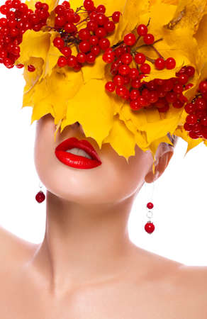 Autumn beautiful female. Natural makeup. Yellow leaves and berries Stock Photo - 16035248
