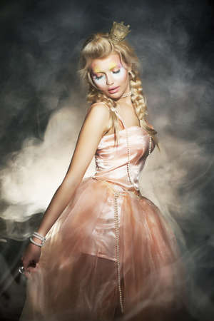 Young blonde woman in classic retro dress. Romantic lady in shadows photo