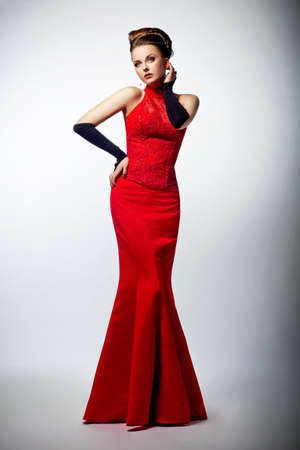 Tempting sexy slim woman bride in sensual red long wedding dress posing Stock Photo - 16061400