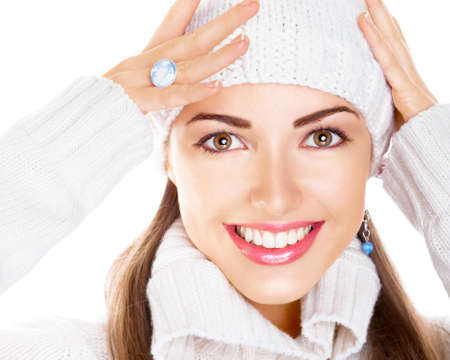 Close up portrait of beauty woman in white cap and pullover. Happy smile photo