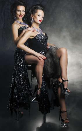 Sensual pair of provocative women girlfriends hugging. Desire. Passion Stock Photo - 16085367