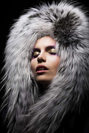 Beautiful young sensual woman in fur fashion collar. Winter style