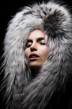 white russian: Beautiful young sensual woman in fur fashion collar. Winter style