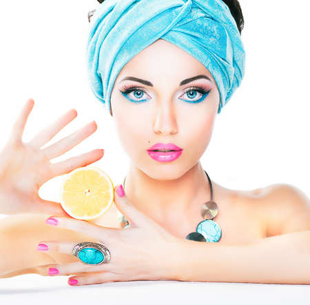 Healthy eating and health care concept  Nutrition  Beauty sexy woman holding fresh lemon  Clean smooth natural skin  photo