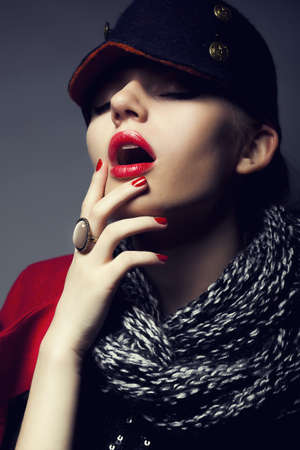 Trendy fashion beautiful female in modern black cap - stylish make-up photo