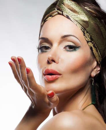 Oriental fashion style. Beautiful woman magic face photo