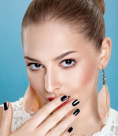 Young sexy girk touching her clean face. Bright black manicure Stock Photo - 16218280