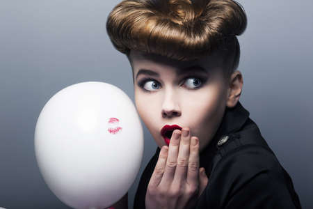 Expression. Surprised pin-up shopper female with white balloon photo