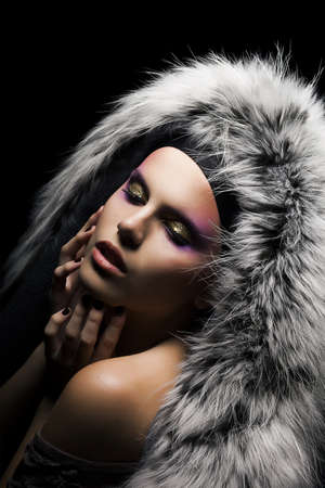 Beauty fashion woman in a coat with grey fox fur collar photo