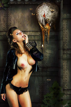 Sexy nude girl licking her finger of dripping honey. Fantasy
