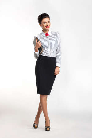 secretary skirt: Portrait of beautiful young business woman with notepad in office