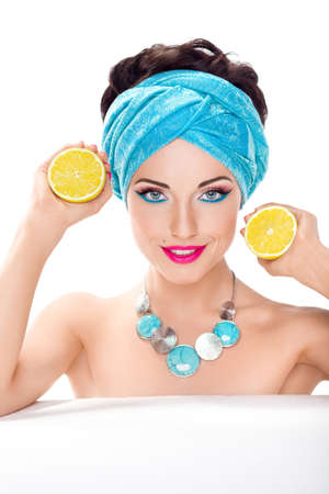 dietician: Smiling beautiful woman with fresh lemon - wholesome food concept Stock Photo