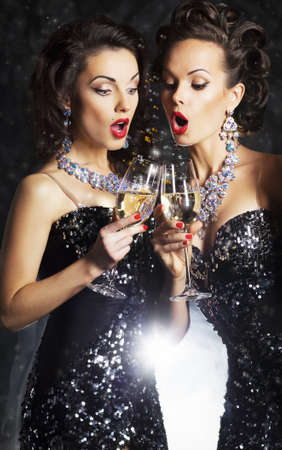 birthday champagne: Couple of cheerful women toasting at party with wine glasses - celebration Stock Photo