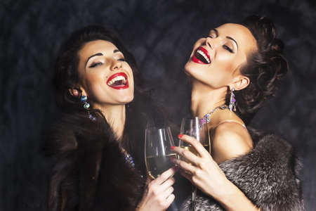 congratulating: Young happy fashion women celebrating the event  Toasting and congratulating