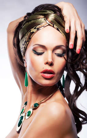 erotic fantasy: Portrait of girl in silk golden shawl - artistic bright visage