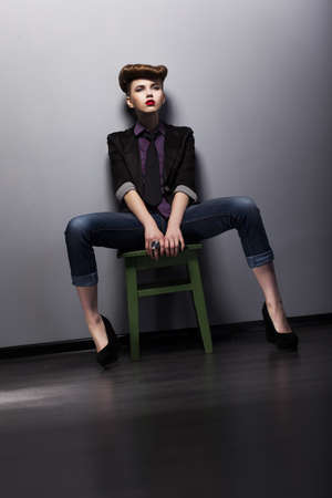 Fashion style - trendy woman mod in elegant stylish garment. Studio shot photo
