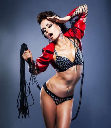 Domination. Fetish. Sexy woman with fetish lash - temptation Stock Photo - 16318968