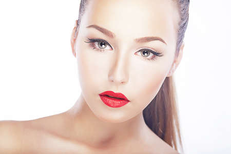 Pure beauty. Luxurious woman face - red lips, natural clean healthy skin photo