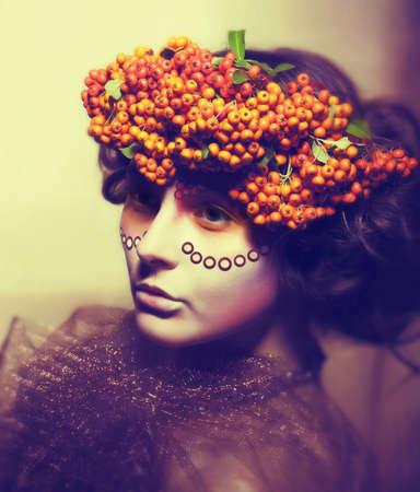 Fairy tale. Floristics. Woman in wreath of rowan berry - grunge Stock Photo - 16614372