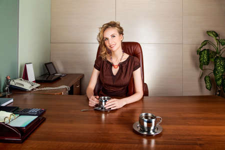 Beautiful business woman boss siting at office desk - happy smile Stock Photo - 16536678