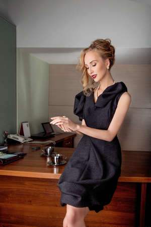 Dreamy businesswoman fashion model in modern office indoors photo