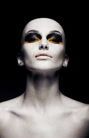 futuristic woman: Beautiful bald futuristic unusual woman - clean shaven head. Conceptual fashion design Stock Photo