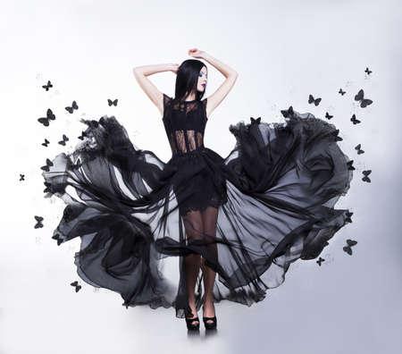 Swing  Flutter  Sensual Woman in Black waving Dress with Butterflies