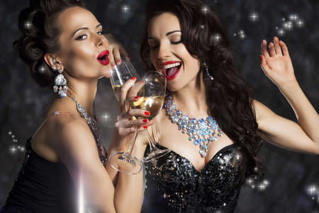 Happy Laughing Women Drinking Champagne, Singing Xmas Song Stock Photo - 16673291