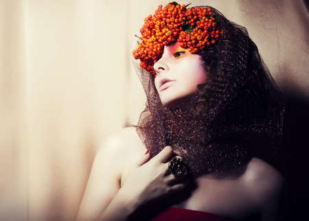 Woman in fresh Wreath of Rowan Berries - Glamor Stock Photo - 16673282