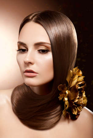 Fashion girl   Beautiful Makeup and Healthy Brown Hair  Flower Stock Photo - 16673281