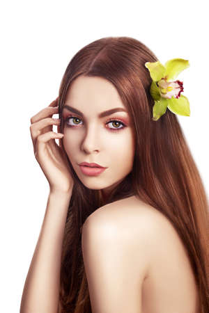 Beautiful Brunette Girl  Healthy Long Hair with Orchid - Spa concept photo