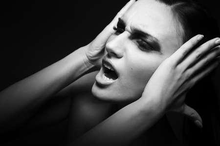 woman headache: Sadness   Woman screaming - headache  Depression, stress Stock Photo