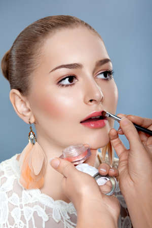 Close-up Young Beauty Woman with Brush for Professional Make-up photo