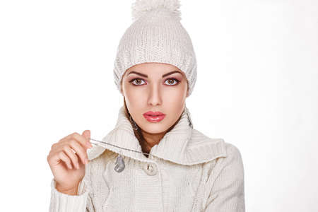 Fresh female Face in White Knitted hat- Winter Style photo
