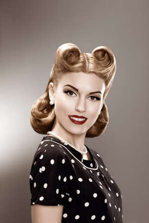 Vintage  Retro Woman in Stylish Polka Dot Dress Portrait - Pin-Up girl Stock Photo - 16969567
