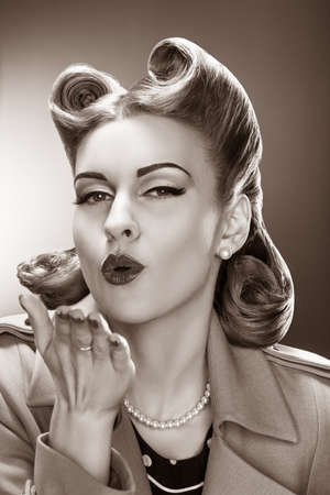 fascinating: Old-fashioned Fascinating Pin-up Girl Blowing a Kiss  Retro Style