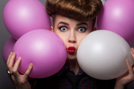 ludicrous: Funny young woman with Colorful Air Balloons Enjoying