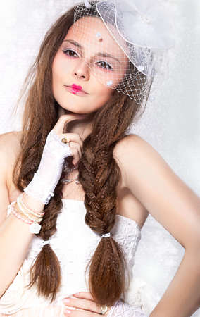 Retro Styled Fashion portrait - Woman in Veil and Gloves. Vintage style Stock Photo - 16891331