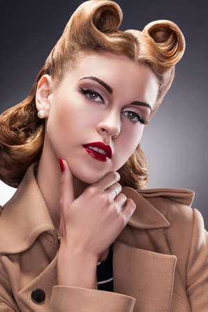 Classy and Trendy Woman in Pin Up Retro Style - Proud Person Stock Photo - 16972532
