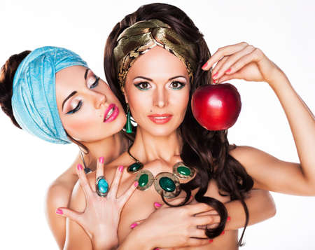 Sensuality. Women Hugging and Holding Red Apple Stock Photo - 16991504