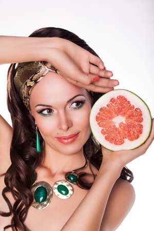 preference: Beautiful Brunette Holding Half of fresh Grapefruit - Preference of Healthy Food Stock Photo