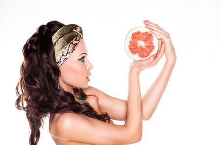 Beauty Young Woman Brunette Preferring Low Calorie Food - Citrus photo