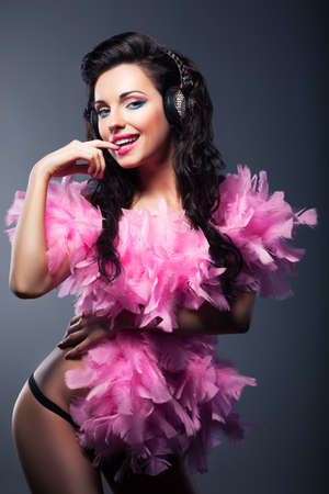Sexy Desirable Woman in Pink Feathers Dancing - Nightlife photo