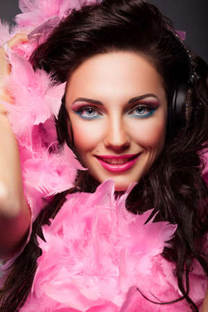 Happy Fashion Woman Face with Feathers Closeup Portrait photo