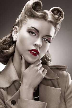 Retro Style. B&W Portrait. Styled Woman with Pin-up Hairdo photo