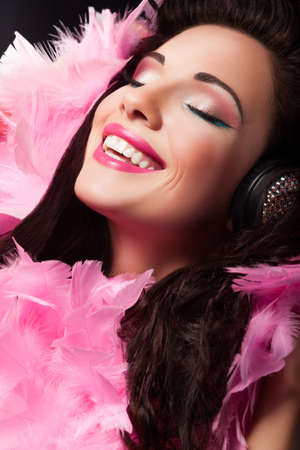 Cheerful Beauty Girl with Pink Feathers Having Fun - Pleasure photo