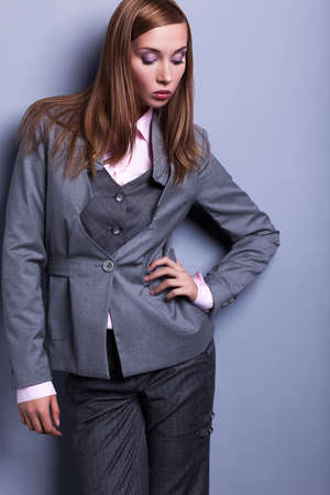 Graceful Stylish Woman in Grey Costume - Vogue Style Stock Photo - 17104292