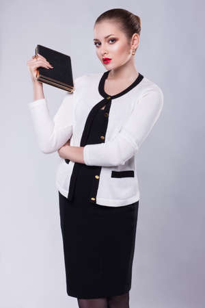 Proud Young Business Woman in Modern Costume with Book Stock Photo - 17093502