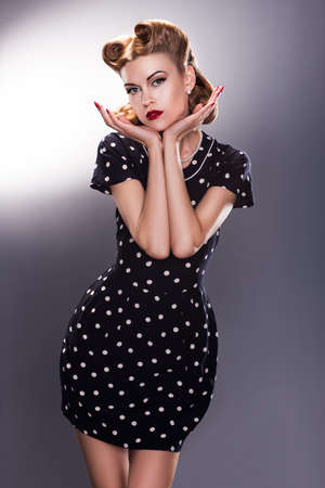 Styled Young Female in Blue Polka Dot Dress - Vintage fashion Style photo
